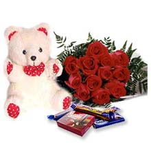 12 red roses bunch + teddy + 5 cadbury chocolates.